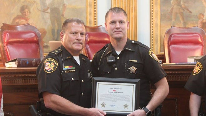 Deputy Nick Shuster, right, was awarded a Gold Star for his actions on May 12 while responding to the shooting at the Pine Kirk Care Center in Kirkersville. Shuster helped remove Kirkersville Chief Steven Eric DiSario from the danger zone and performed CPR until medics arrived.