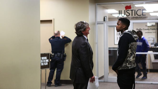 December 1, 2017 - Attorney Leslie Ballin (left) confers with his client, former University of Memphis basketball player Joe Jackson, at the Shelby County Criminal Justice Center on Friday.