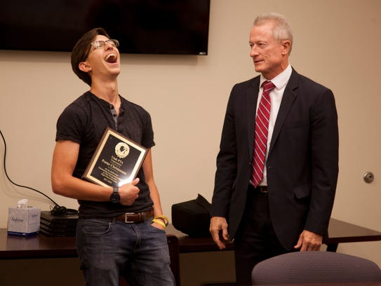 Porter Christensen (left) laughs with Washington County School District Superintendent Larry Bergeson at Pine View High School on May 4, 2018.