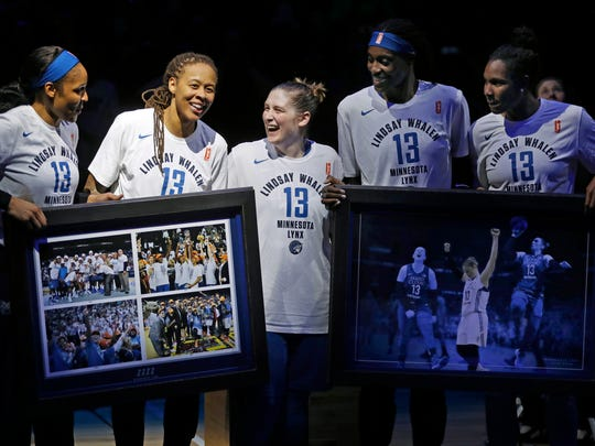 Lindsay Whalen, center, smiles with her teammates during a ceremony honoring her last regular season game for the Minnesota Lynx Sunday, Aug. 19, 2018, in Minneapolis. Whalen scored 10 points in the final regular-season home game of her career. (Richard Tsong-Taatarii/Star Tribune via AP) (Photo: The Associated Press)