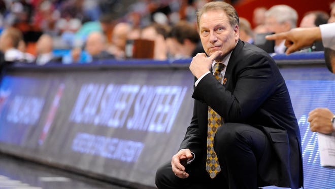 MSU head coach Tom Izzo watches the clock as the Spartans try to hold on to their victory  against Oklahoma                       during their NCAA  game in Syracuse, NY Friday 3/27/2015.