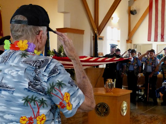 Don Crandell, who was a young boy at the time of the Dec. 7, 1941 attack at Pearl Harbor, pays tribute Friday to Mel Fisher.