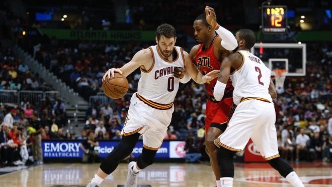 Cleveland Cavaliers forward Kevin Love (0) controls the ball against the Atlanta Hawks in the first quarter at Philips Arena.