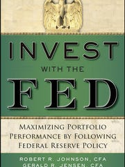 """The book """"Invest with the Fed"""" breaks down strategies"""