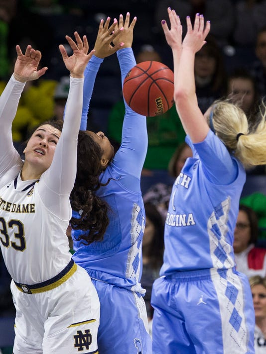Notre Dame's Kathryn Westbeld (33) competes with North Carolina's Jocelyn Jones, center, and Taylor Koenen (1) for the ball during the first half of an NCAA college basketball game Thursday, Feb. 1, 2018, in South Bend, Ind. (AP Photo/Robert Franklin)
