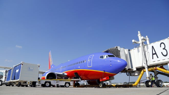 A Southwest Airlines plane is serviced at the gate Wednesday, Sept. 25, 2013, at the Des Moines International Airport.