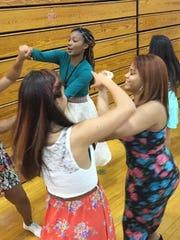 Vineland High School dance instructor N'Talia Wilson (center) teaches merengue during the VIneland High  School Hispanic Heritage Month celebration Thursday.