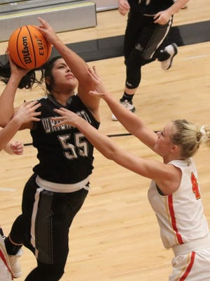 Dale's Jacie McClure (right) defends a Wright City player during regional playoff action a couple of weeks ago. McClure is one of two Lady Pirate seniors who may have missed out on playing in the state tournament due to the coronavirus.
