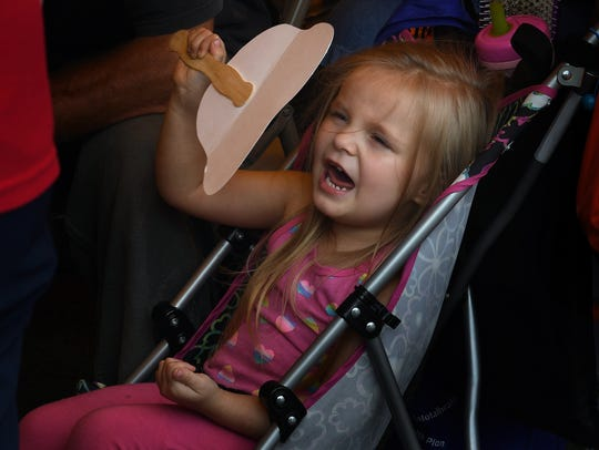 Kaitlen Hagy, 3, tries to keep cool with a hand fan