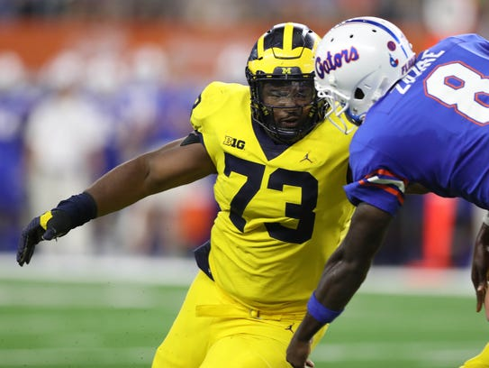 Michigan's Maurice Hurst pressures Florida's Malik
