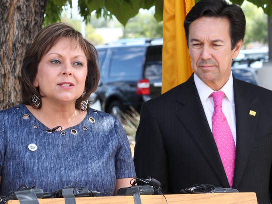 New Mexico Gov. Susana Martinez is joined by outgoing