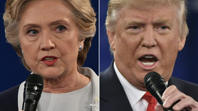 This combination of pictures shows Democratic presidential candidate Hillary Clinton and Republican presidential candidate Donald Trump during the second presidential debate at Washington University in St. Louis.