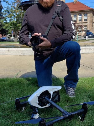 Justin with his DSLR camera and drone in Clinton's Central Park.