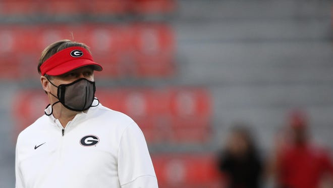 Georgia coach Kirby Smart looks on during warm ups before the start of an NCAA college football game between Georgia and Auburn in Athens, Ga., on Saturday, Oct. 3, 2020.