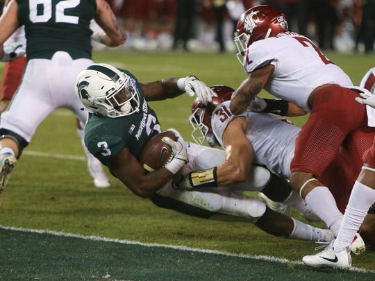 Michigan State RB LJ Scott scores against Washington State during the second quarter of the San Diego County Credit Union Holiday Bowl on Thursday, Dec. 28, 2017, at SDCCU Stadium in San Diego.