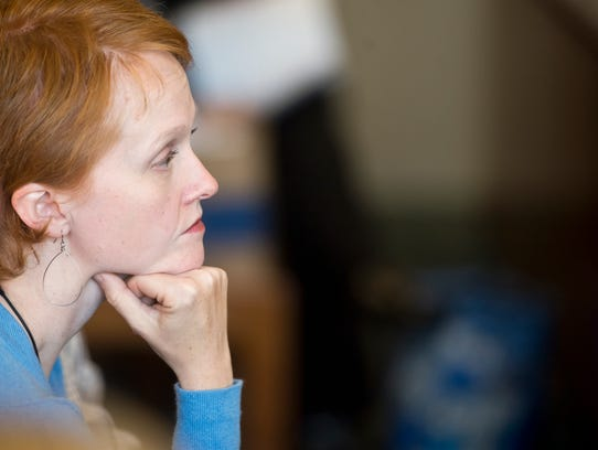 Colleen Bray listens to testimony from Burlington Police