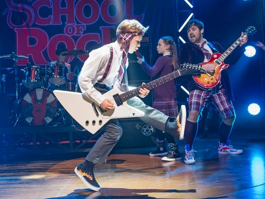 """""""School of Rock,"""" the movie, really revolved around its star, Jack Black. However, in the stage production, the kids, who play their own instruments onstage, are the stars,  says associate director David Ruttura. (The original London cast is pictured.)"""