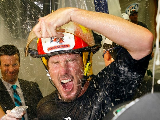 Detroit Tigers relief pitcher Joe Nathan (36) gets showered with champagne after winning the Central Division Championship by defeating the Minnesota Twins 3-0 on Sept. 28, 2014, at Comerica Park.