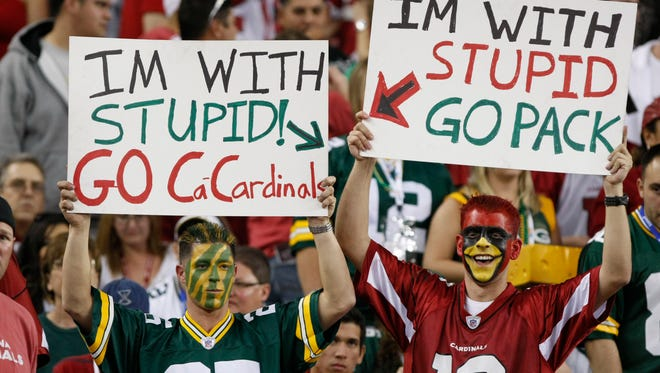 Nick Wagner (left) of Arkdale, Wisc., and David Ricardo of Tempe hold their signs during an NFC wild-card playoff game on Sunday, Jan. 10, 2010, at the University of Phoenix Stadium in Glendale.