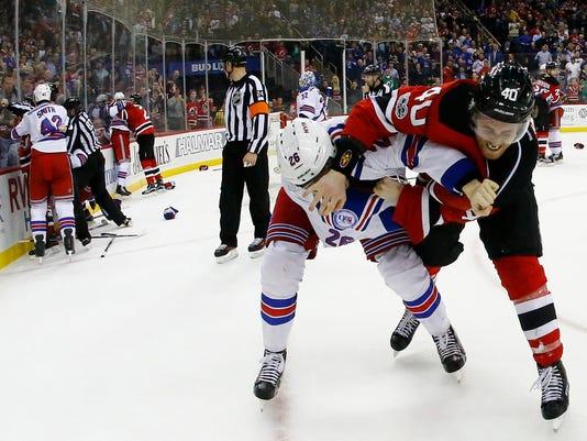 636257301677411715-Rangers-Devils-Hockey-njha.jpg