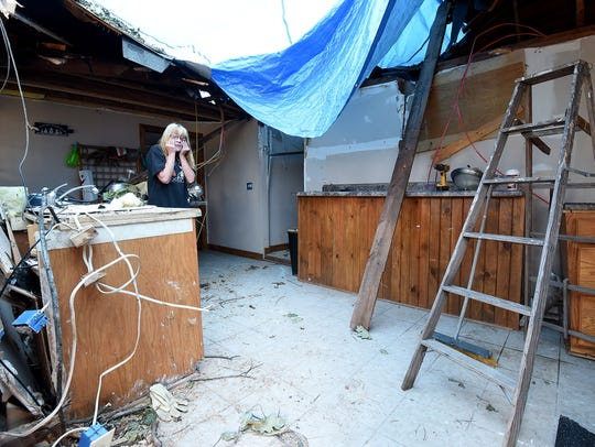 Sherri Hager, of 2610 Stiving Road, wipes tears from