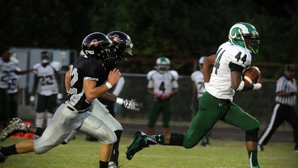 Parkside's Nayel Oge (44) sprints away from Colonel