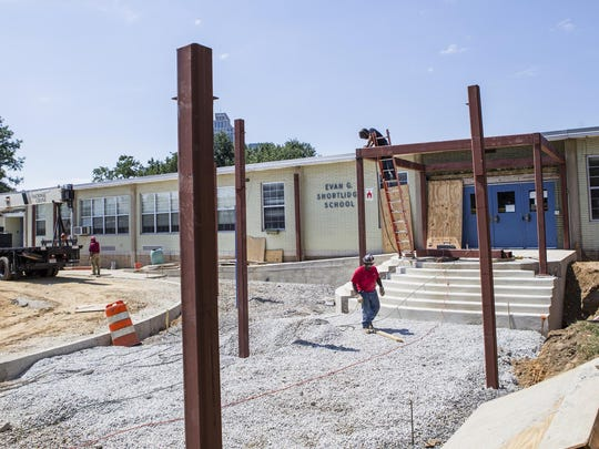 Construction crew members work at Shortlidge Elementary School.