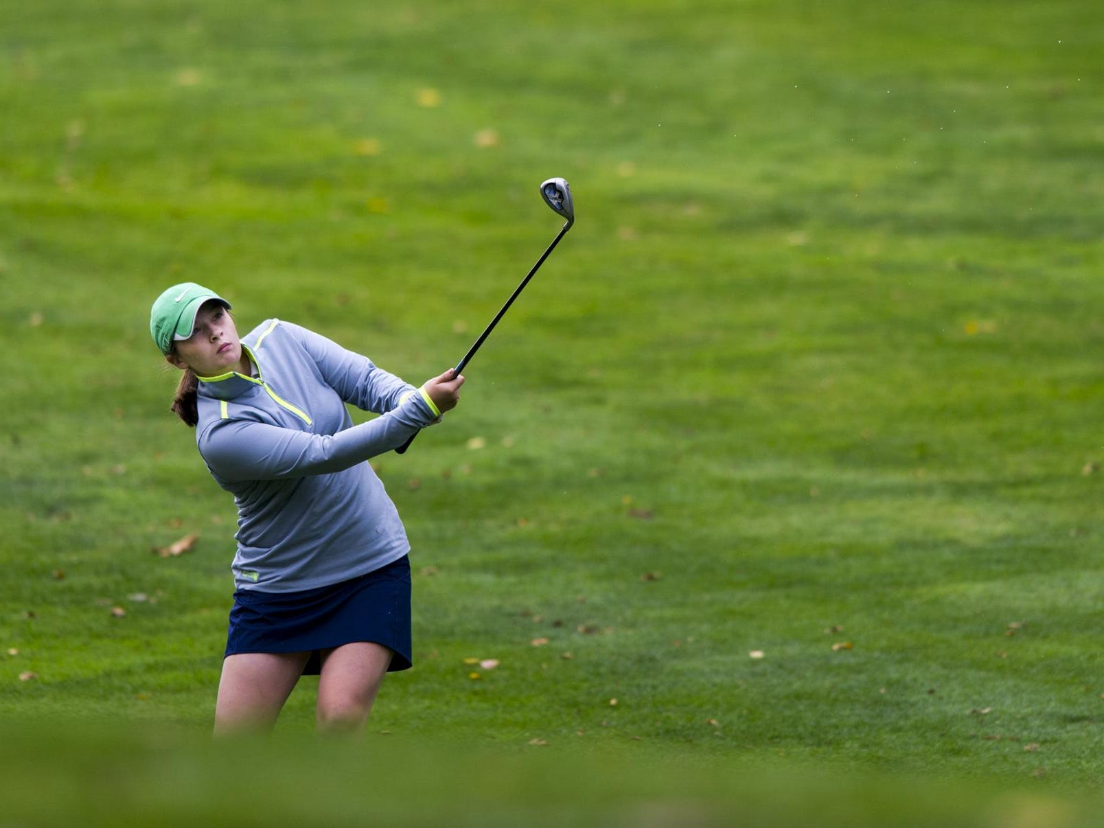 Cathedral golfer Betsy Werner knocks her ball onto the green during the IHSAA girls golf regional hosted by Lapel at Edgewood Golf Course in Anderson, Ind., Sept. 26, 2015.