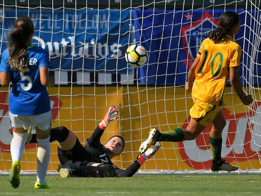 Brazil goalkeeper Dani Neuhaus, center, is scored on by Australia's Lisa De Vanna as Sam Kerr, right, celebrates and Djenifer watches during the first half of a Tournament of Nations soccer match, Thursday, Aug. 3, 2017, in Carson, Calif. (AP Photo/Mark J. Terrill)