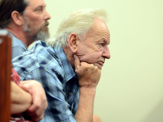 Butch Watkins, father of Brittney Simpson, leans forward while listening to testimony from TBI Investigator Mike Parson during the preliminary hearing of Luis Mendoza and Carlos Ramirez on Tuesday in Henderson County.