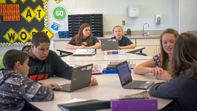 Students in Carrie Young's sixth-grade class work through an exercise on their laptops practicing for the the Common Core State Standards Test at Morgan Elementary School South in Stockport, Ohio, on Feb. 12, 2015.