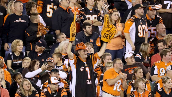 Bengals fan John Clarke waves his Who Dey foam fingers as the Bengals take on the Browns Nov. 4 at Paul Brown Stadium.