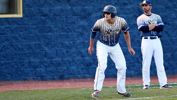 Roberson's Aaron McKeithan prepares to run home in