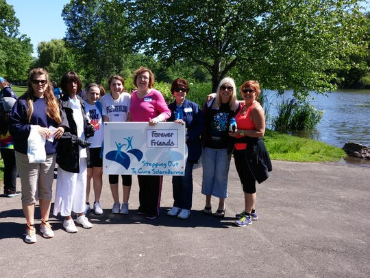 Rosa Johnson, second from left, with her team at a Stepping Out to Cure Scleroderma walk in Rochester.