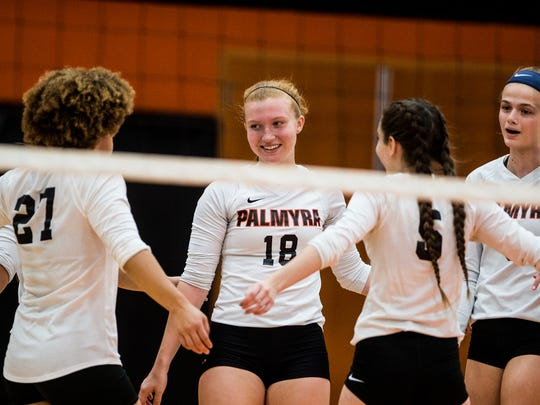 Palmyra Destiny Farkas, Kirstin West (21), Rachel Hutchinson (18), Hannah Ziegler, (5) and Taylor McInerney celebrate as Palmyra defeated Wyomissing 3-0 in the first round of the PIAA District III volleyball tournament on Saturday, Oct. 28, 2017.