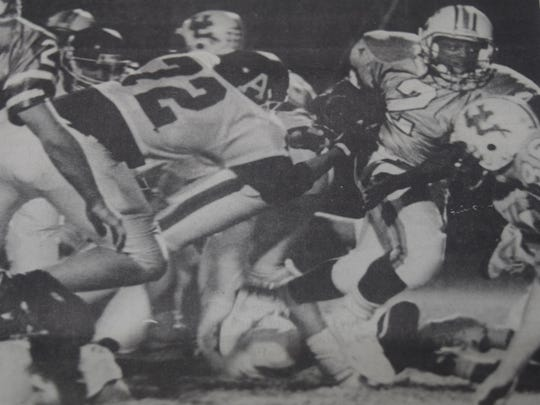 Running back Tommy Tyler breaks through the offensive