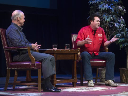 John Schnatter, right, founder and chairman of Papa John's, fields questions from the audience March 28, 2017, in Loeb Playhouse during a Q&A with Purdue President Mitch Daniels.