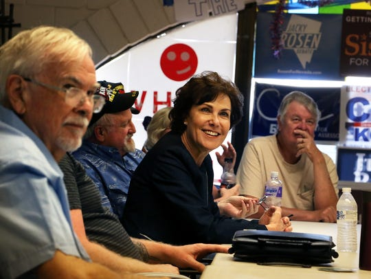 U.S. Representative Jacky Rosen, middle, meets with