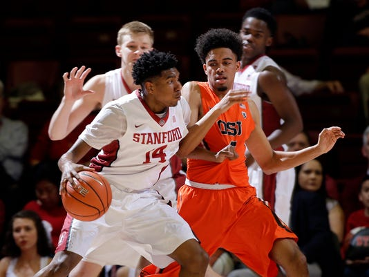 Stanford guard Marcus Sheffield (14) dribbles next to Oregon State guard Stephen Thompson Jr. during the first half of an NCAA college basketball game Thursday, Feb. 11, 2016, in Stanford, Calif. (AP Photo/Marcio Jose Sanchez)