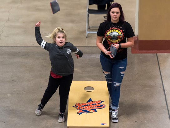 Addison Renegar, left, and Sidney Fiveash pass the