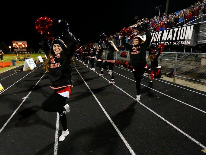 Ravenwood cheerleaders perform during their game against