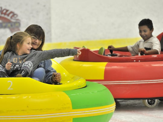 """Seven-year-old Miariah Walton of Seaford gets a chance to test """"Bumper Cars on Ice"""" with the help of her aunt Mary Walton in 2017."""