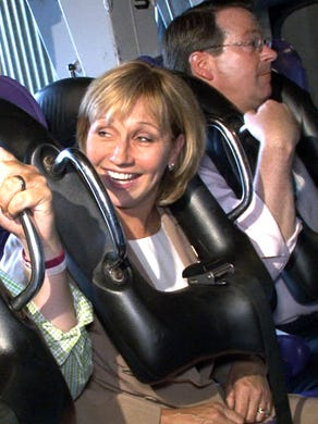 2015: Assemblyman Robert Clifton (R-Monmouth) and New Jersey Lt. Gov. Kim Guadagno is still smiling before they get launched along with Six Flags Great Adventure president Jim Fitzgerald on Batman The Ride.