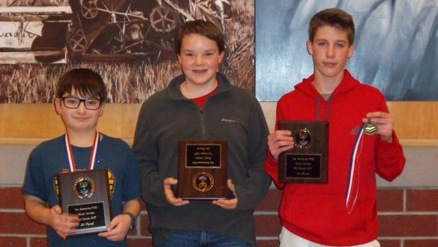 Left to right, Josh Baumann, Matthew Sesing, Braeden Gerritson were the sixth, seventh and eighth grade winners, respectively, of the annual Fond du Lac Reporter Middle School Math Contest.
