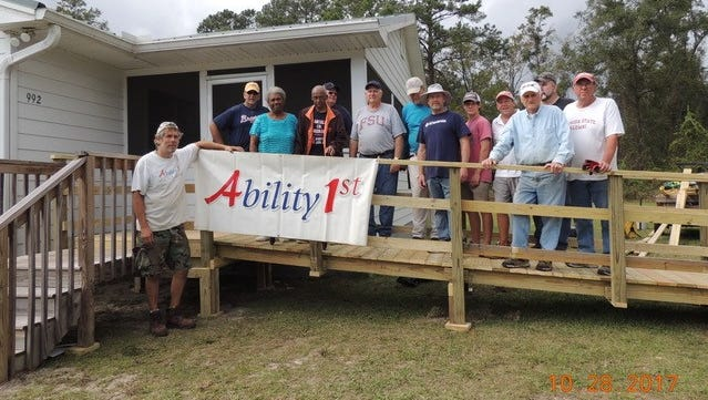 Members of the Northside Kiwanis Club gather for a picture outside Ability1st