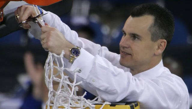 Billy Donovan cuts down the net after Florida beat UCLA, 73-57, in the Final Four national championship basketball game in Indianapolis, Monday April 3, 2006.