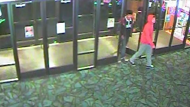 The Lyon County Sheriff's Office released photos taken from a surveillance video showing two suspects wanted in connection to a fatal shooting in Dayton.