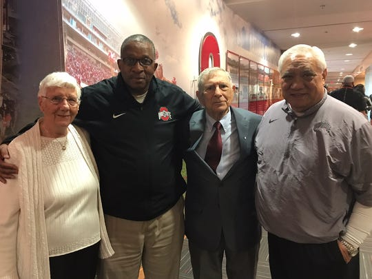 Stan Jefferson (second from left) , who has resigned as Ohio State's Director of Player Development, is flanked by Ruth and Fred Martinelli and joined by OSU football administrator Hiram Defries during a ceremony on campus this past spring honoring Fred Martinelli on campus. Jefferson coached for Martinelli, a member of the College Football Hall of Fame, at Ashland University before becoming head football coach and then principal at Mansfield Senior.