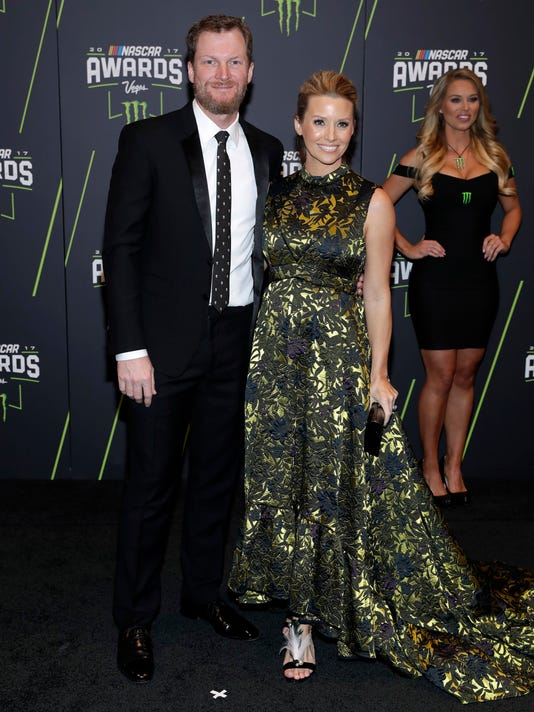 Dale Earnhardt Jr., left, and Amy Earnhardt arrive at the NASCAR Cup Series auto racing awards Thursday, Nov. 30, 2017, in Las Vegas. (AP Photo/Isaac Brekken)
