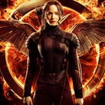The final poster for 'The Hunger Games: Mockingjay Part 1' has arrived.